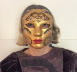 Nadia Wheatley modelling the magnificent mask decorated by Ken Searle.